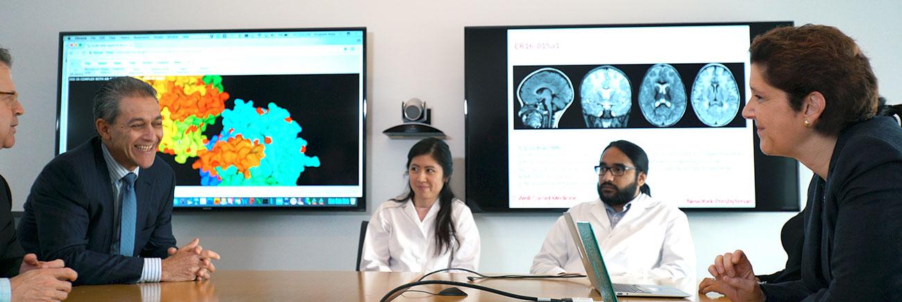 Weill Cornell Medicine Neurogenetics specialists at a meeting.